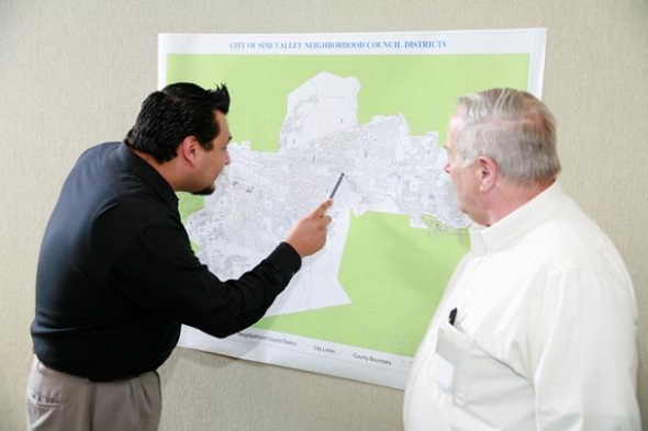 Neighborhood Council Executive Board Members looking at map