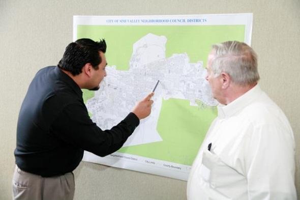 Neighborhood Council Executive Board Members looking at map