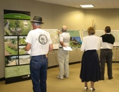 Adults Looking at Arroyo Simi Displays