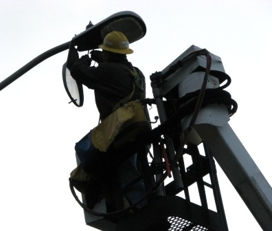 Streetlight Being Repaird by Worker in Lift